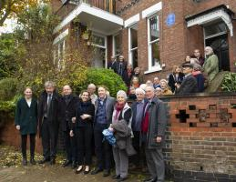Attendees standing front of the brick building that was the Hampstead home of Milein Cosman and Hans Keller after blue plaque unveiled.