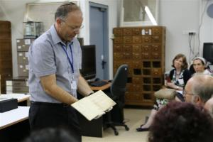 Project Chair Haim Gertner presenting a piece of archival material